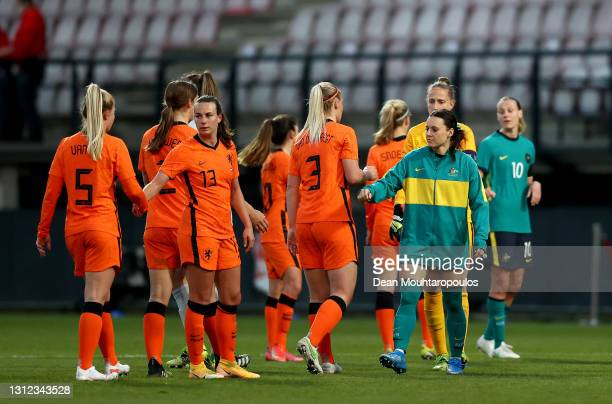 The players interact after the International Friendly match between Netherlands Women and Australia Women at Stadion de Goffert on April 13, 2021 in...