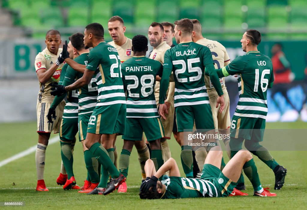 The players jostle against each other after a foul during the Hungarian OTP Bank Liga match between Ferencvarosi TC and Videoton FC at Groupama Arena on December 2, 2017 in Budapest, Hungary.