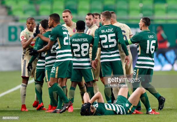 The players jostle against each other after a foul during the Hungarian OTP Bank Liga match between Ferencvarosi TC and Videoton FC at Groupama Arena...