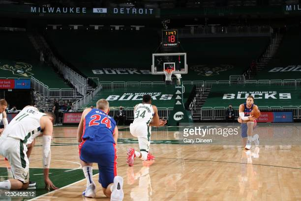 The players kneel during the game on January 6, 2021 at the Fiserv Forum Center in Milwaukee, Wisconsin. NOTE TO USER: User expressly acknowledges...