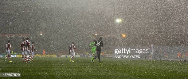 the players leave the pitch due to bad weather during the English League Cup QuarterFinal football match between Stoke City And Manchester United at...