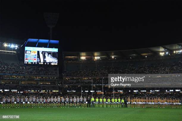 The players line up for a tribute to Lou Richards during the round nine AFL match between the Collingwood Magpies and the Hawthorn Hawks at Melbourne...