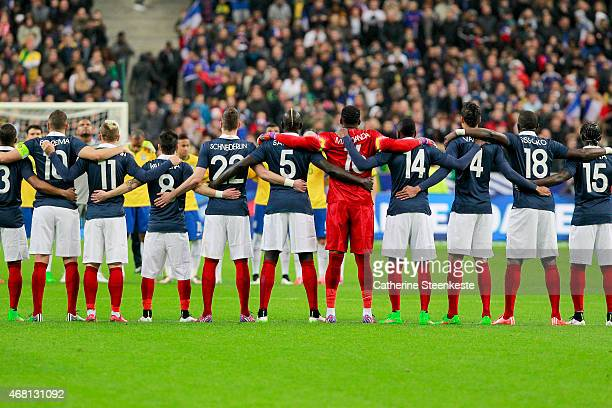 The players line up for one minute of silence for the recent Germanwings flight 4U9525 plane crash before the international friendly game between...
