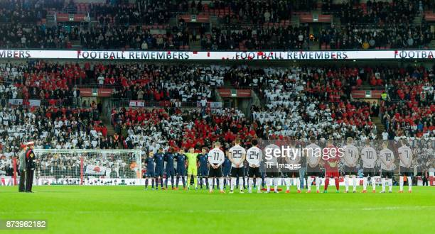 The players line up for rememberance during the international friendly match between England and Germany at Wembley Stadium on November 10 2017 in...