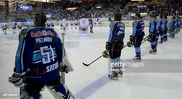 The players line up prior to game six of the DEL final playoffs between ERC Ingolstadt and Koelner Haie at Saturn Arena on April 27 2014 in...