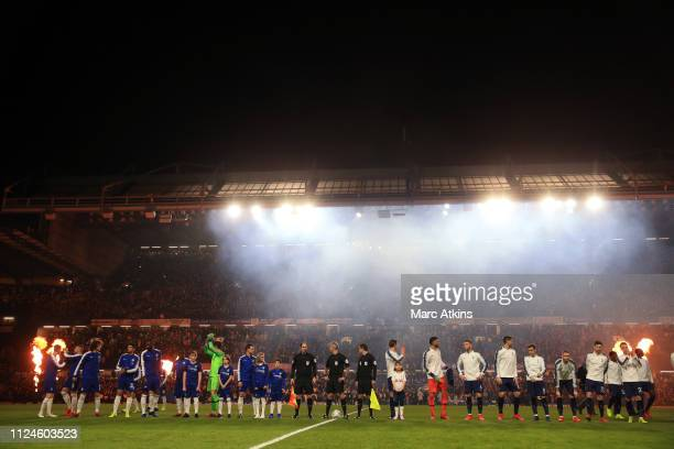 The players line up under a blanket of smoke before kick off during the Carabao Cup SemiFinal Second Leg match between Chelsea and Tottenham Hotspur...