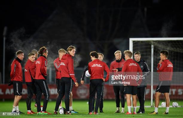 The players listening to Jon Dahl Tomasson assistant coach during the Denmark training session at Helsingor Stadion on November 7 2017 in Helsingor...