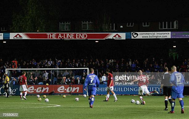 The players look on as footballs are suddenly fired on to the pitch midgame during the FA Cup First Round match between Macclesfield Town and Walsall...