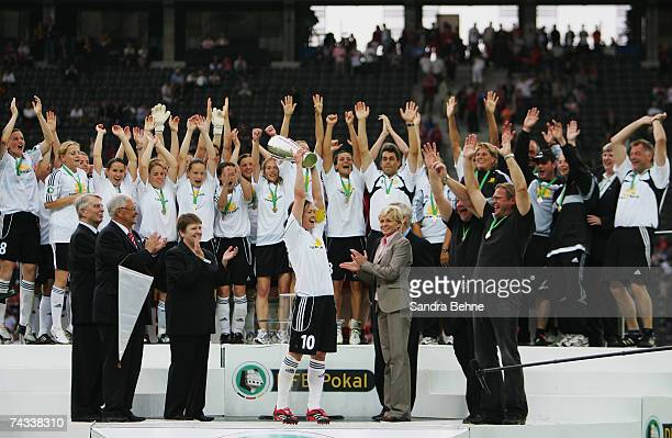 The players of 1FFC Frankfurt celebrate with the trophy after winning the Women's German Cup Final football match against FCR Duisburg at the Olympic...