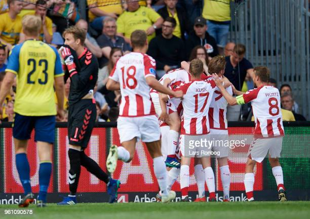 The players of AaB Aalborg celebrate after the 10 goal scored by Kasper Risgard of AaB Aalborg during the Danish Alka Superliga match between Brondby...