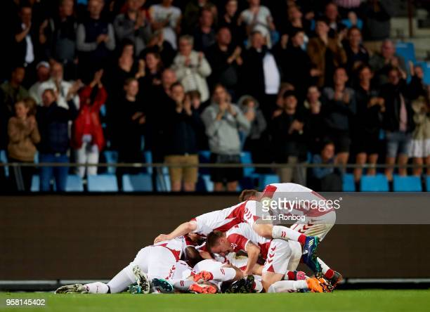 The players of AaB Aalborg celebrate after the 10 goal scored by Kasper Kusk during the Danish Alka Superliga match between AaB Aalborg and FC...