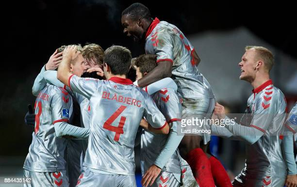 The players of AaB Aalborg celebrate after the 20 goal scored by Rasmus Thellufsen during the Danish Alka Superliga match between Lyngby BK and AaB...
