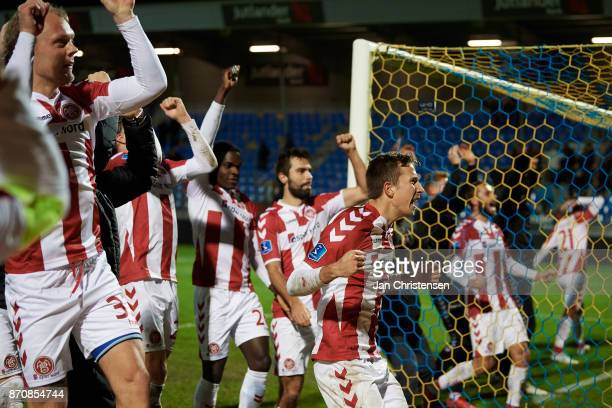 The players of AaB Aalborg celebrate after the Danish Alka Superliga match between Hobro IK and AaB Aalborg at DS Arena on November 05 2017 in Hobro...