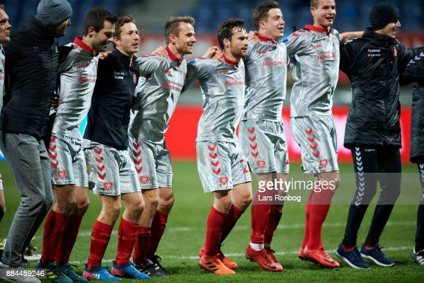 The players of AaB Aalborg celebrate after the Danish Alka Superliga match between Lyngby BK and AaB Aalborg at Lyngby Stadion on December 2 2017 in...
