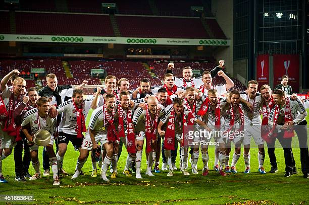 The players of AaB Aalborg celebrate after the DBU Pokalen Cup Final match between AaB Aalborg and FC Copenhagen in Parken Stadium on May 15 2014 in...