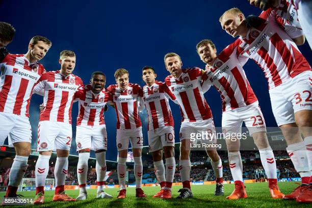 The players of AaB Aalborg huddle poor to the Danish Alka Superliga match between AaB Aalborg and FC Copenhagen at Aalborg Portland Park on December...