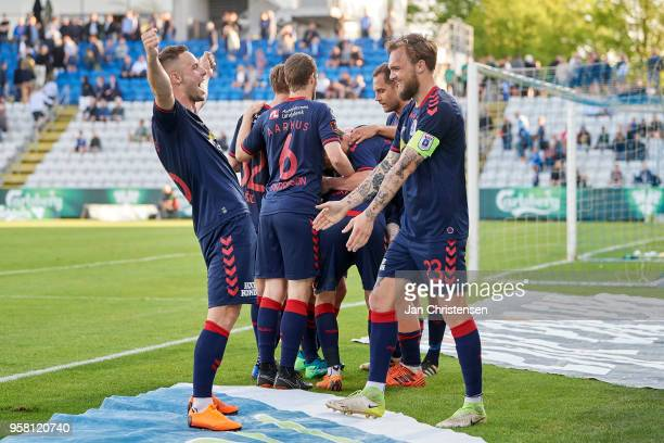 The players of AGD Arhus celebrate after the 23 goal from Jakob Ankersen during the Danish Alka Superliga match between OB Odense and AGF Arhus at...