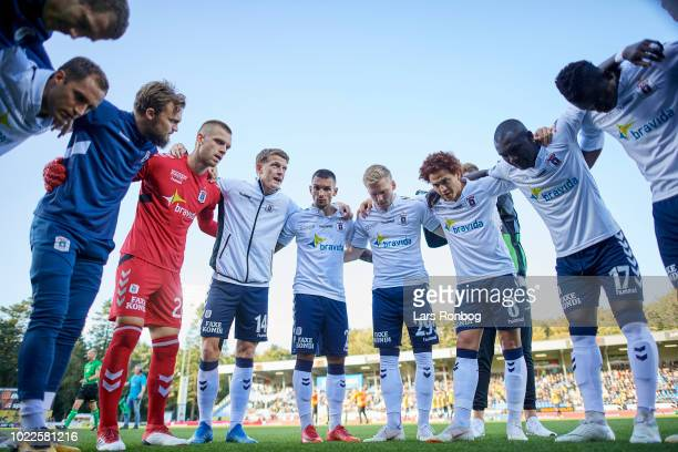 The players of AGF Aarhus huddle prior to the Danish Superliga match between Hobro IK and AGF Aarhus at DS Arena on August 24 2018 in Hobro Denmark