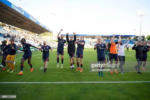 The players of AGF Arhus celebrate after the Danish Alka Superliga match between OB Odense and AGF Arhus at EWII Park on May 13 2018 in Odense Denmark