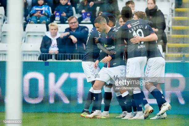 The players of AGF Arhus celebrating the 01 goal from Jakob Ankersen during the Danish Superliga match between OB Odense and AGF Arhus at Nature...