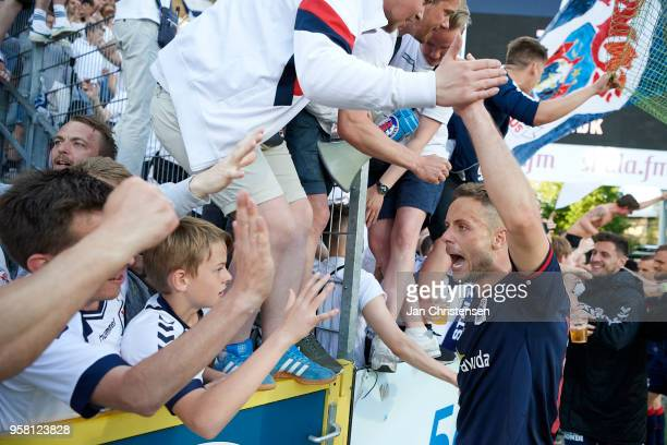 The players of AGF celebrating with fans after the Danish Alka Superliga match between OB Odense and AGF Arhus at EWII Park on May 13 2018 in Odense...