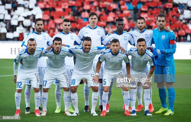 The players of Apollon Limasson pose for a group picture prior to the UEFA Europa League Playoff 2nd Leg match between FC Midtjylland and Apollon...