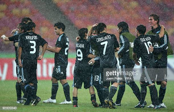 The players of Argentina celebrate after the FIFA U17 World Cup Group A match between Honduras and Argentina at the Abuja National Stadium on October...