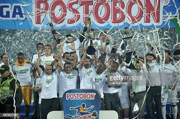 The players of Atletico Nacional lift the trophy as champions of the Liga Postobon I 2014 after defeat Atletico Junior during a second leg match...