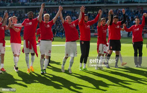 The players of Augsburg celebrate after the Bundesliga match between TSG 1899 Hoffenheim and FC Augsburg at Wirsol RheinNeckarArena on May 20 2017 in...