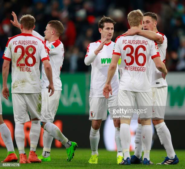 The players of Augsburg celebrate at the end of the Bundesliga match between FC Augsburg and Werder Bremen at WWK Arena on February 5 2017 in...