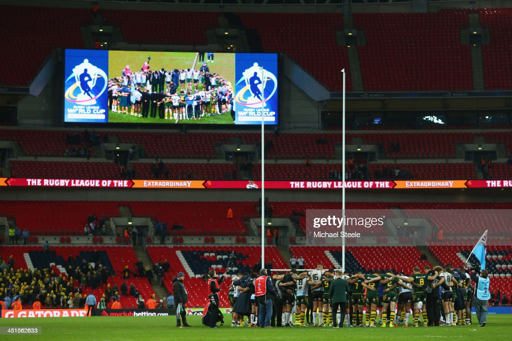 The players of Australia and Fiji gather in the centre circle to pray after Australias 64-0 victory during the Rugby League World Cup Semi Final match between Australia and Fiji at Wembley Stadium on November 23, 2013 in London, England.