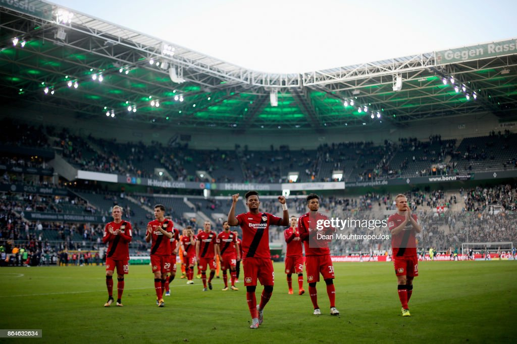 The players of Bayer 04 Leverkusen celebrate in front of their fans after victory in the Bundesliga match between Borussia Moenchengladbach and Bayer 04 Leverkusen at Borussia-Park on October 21, 2017 in Moenchengladbach, Germany.