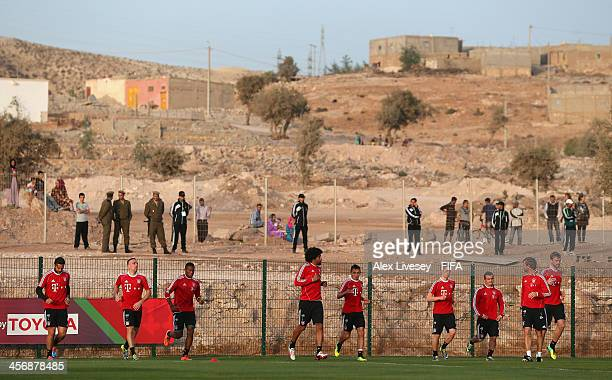 The players of Bayern Muenchen warm up during a training session at the Agadir Stadium on December 15 2013 in Agadir Morocco