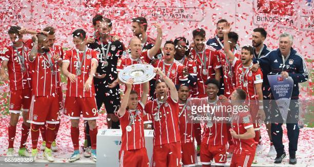The players of Bayern Munich celebrate with the trophy after winning the championship during the Bundesliga soccer match between FC Bayern Munich and...