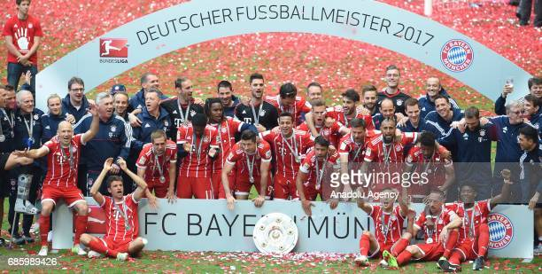 The players of Bayern Munich pose with the trophy after winning the championship during the Bundesliga soccer match between FC Bayern Munich and SC...