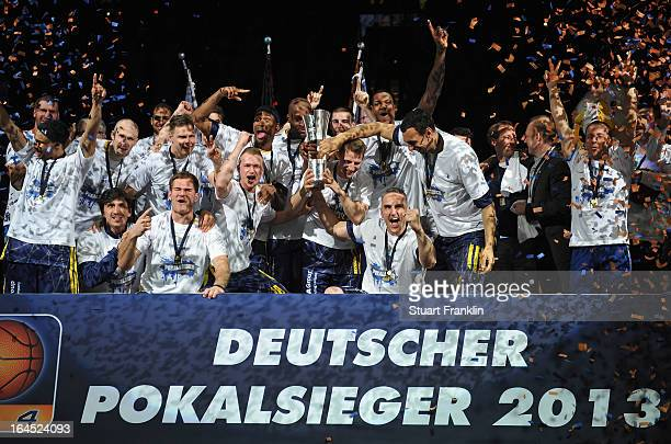The players of Berlin celebrate after winning the Beko BBLTop Four final game between Ratiopharm Ulm and Alba Berlin at O2 World on March 24 2013 in...