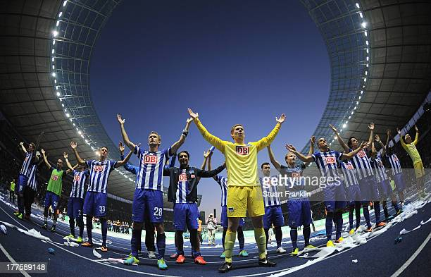 The players of Berlin celebrate their win at the end of the Bundesliga match between Hertha BSC and Hamburger SV at Olympiastadion on August 24 2013...