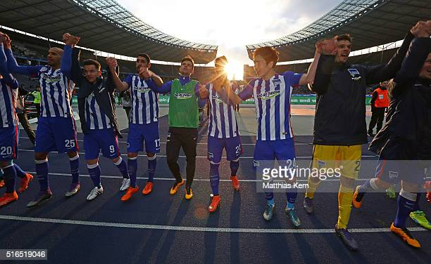 The players of Berlin celebrate with their supporters after winning the Bundesliga match between Hertha BSC and FC Ingolstadt at Olympiastadion on...