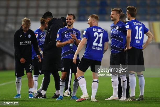 The players of Bielefeld look happy after the final whistle during the Second Bundesliga match between DSC Arminia Bielefeld and SG Dynamo Dresden at...