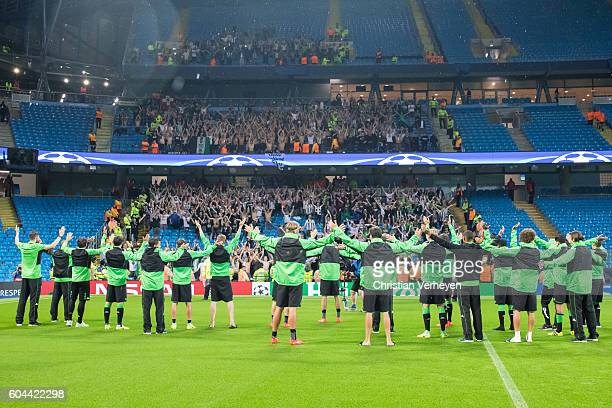 The players of Borussia celebrate with their supporters after the cancelled Champions League match between Manchester City and Borussia...