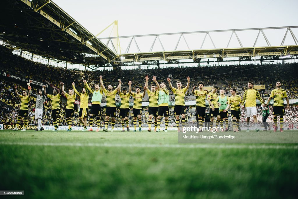 The players of Borussia Dortmund celebrate witht the fans after the Bundesliga match between Borussia Dortmund and VfB Stuttgart at Signal Iduna Park on April 8, 2018 in Dortmund, Germany.