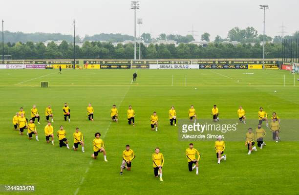 The players of Borussia Dortmund kneel down in support of the Black Lives Matter Movement during a training session on June 04 2020 in Dortmund...