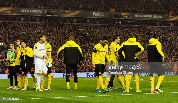 The players of Borussia Dortmund look dejected after the final whistle during the UEFA Europa League Quarter Final Second Leg match between Liverpool...