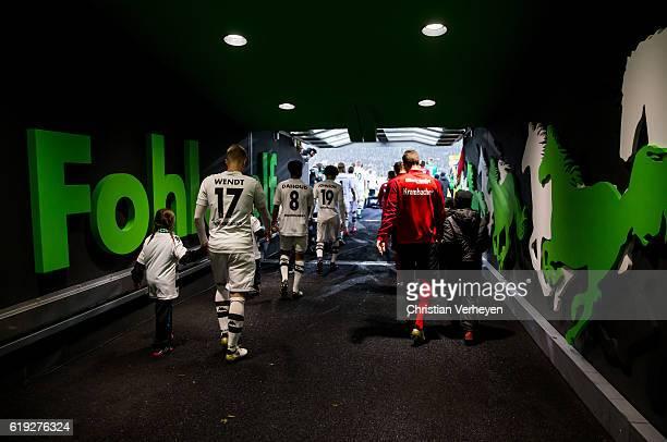 The players of Borussia Monechengladbach and Eintracht Frankfut enter the pitch ahead the Bundesliga match between Borussia Moenchengladbach and...