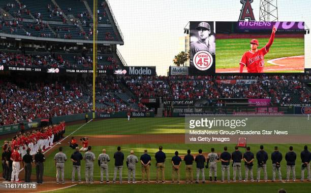 The players of both teams line up during a tribute for pitcher Tyler Skaggs who passed away on On July 1 2019 prior to a MLB baseball game between...