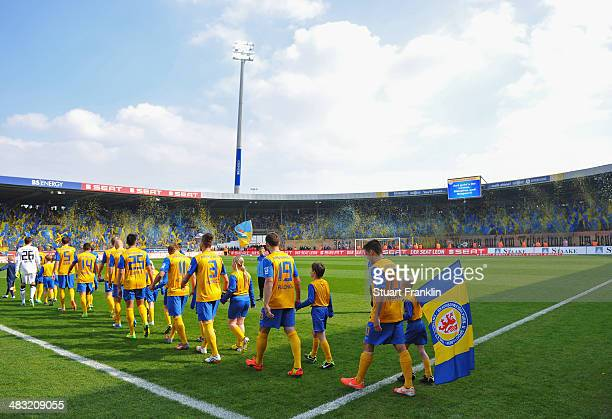 The players of Braunschweig walk out at the start of the Bundesliga match between Eintracht Braunschweig and Hannover 96 at Eintracht Stadion on...