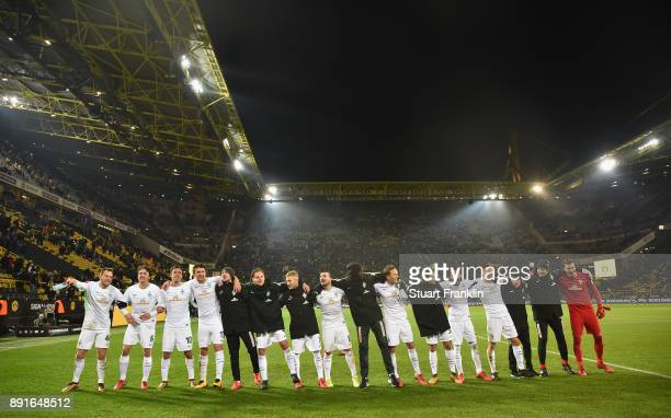 The players of Bremen celebrate after the Bundesliga match between Borussia Dortmund and SV Werder Bremen at Signal Iduna Park on December 9 2017 in...