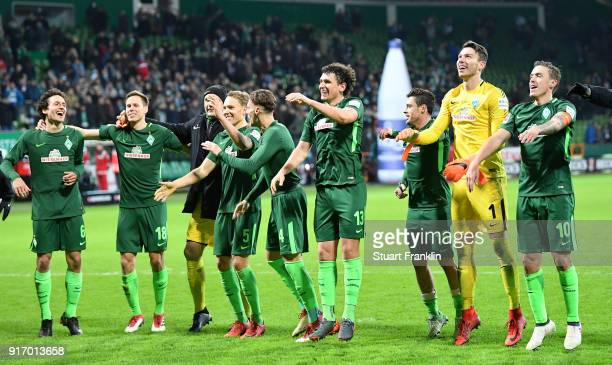 The players of Bremen celebrate after the Bundesliga match between SV Werder Bremen and VfL Wolfsburg at Weserstadion on February 11 2018 in Bremen...