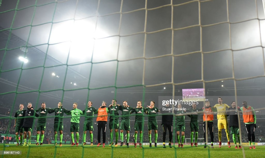 The players of Bremen celebrate after the DFB Cup match between Werder Bremen and SC Freiburg at Weserstadion on December 20, 2017 in Bremen, Germany.