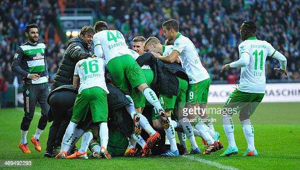 The players of Bremen celebrate their teams goal during the Bundesliga match between Werder Bremen and Borussia Moenchengladbach at Weserstadion on...